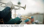 A wind instrument military parade - men in costumes playing trumpets outdoors. Стоковое видео, видеограф Константин Шишкин / Фотобанк Лори