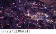 Купить «Evening aerial view of medieval Spanish town of Daroca with illuminated Basilica of St. Mary of Sacred Body», видеоролик № 32069213, снято 9 марта 2019 г. (c) Яков Филимонов / Фотобанк Лори
