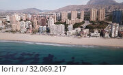 Купить «Aerial view of coast at Benidorm cityscape with a modern apartment buildings, Spain», видеоролик № 32069217, снято 17 апреля 2019 г. (c) Яков Филимонов / Фотобанк Лори