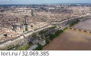 Купить «Day aerial cityscape of Bordeaux city and Garonne river in France», видеоролик № 32069385, снято 18 июля 2019 г. (c) Яков Филимонов / Фотобанк Лори