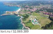 Купить «Aerial panoramic view of summer landscape overlooking small Spanish town of Comillas on coast of Cantabrian Sea», видеоролик № 32069389, снято 14 июля 2019 г. (c) Яков Филимонов / Фотобанк Лори