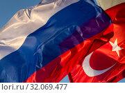 Купить «Государственные флаги Российской Федерации и Турецкой Республики развиваются на ветру», фото № 32069477, снято 23 августа 2019 г. (c) Николай Винокуров / Фотобанк Лори