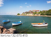 Купить «Beautiful seascape. Three motor boats in the bay of the Black Sea on background of sea promenade of Nessebar city, Bulgaria», фото № 32073413, снято 26 июня 2019 г. (c) Юлия Бабкина / Фотобанк Лори