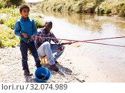 Купить «Man and boy fishing with rods», фото № 32074989, снято 26 мая 2019 г. (c) Яков Филимонов / Фотобанк Лори