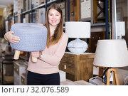 Купить «smiling woman buyer choosing pouf», фото № 32076589, снято 15 ноября 2017 г. (c) Яков Филимонов / Фотобанк Лори