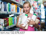 Купить «Happy girl holding shampoo and shower gel», фото № 32076637, снято 5 августа 2017 г. (c) Яков Филимонов / Фотобанк Лори