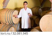 Купить «taster of winery with wine in cellar», фото № 32081945, снято 21 сентября 2016 г. (c) Яков Филимонов / Фотобанк Лори