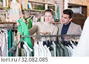 Купить «Couple is choosing jacket for her», фото № 32082085, снято 12 марта 2018 г. (c) Яков Филимонов / Фотобанк Лори
