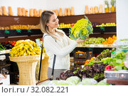 Woman choosing vegetables in greengrocery. Стоковое фото, фотограф Яков Филимонов / Фотобанк Лори
