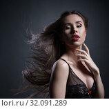 Купить «Erotica. Sensual girl posing with hair fluttering», фото № 32091289, снято 4 февраля 2016 г. (c) Гурьянов Андрей / Фотобанк Лори
