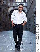 Купить «Man in formalwear walking along street», фото № 32091465, снято 5 августа 2017 г. (c) Яков Филимонов / Фотобанк Лори