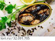 Купить «Chipirones in ink with herbs and lemon», фото № 32091705, снято 21 сентября 2019 г. (c) Яков Филимонов / Фотобанк Лори