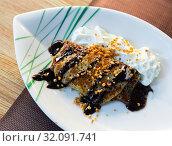 Купить «Thin pancake with chocolate, whipped cream, nut crumbs», фото № 32091741, снято 16 сентября 2019 г. (c) Яков Филимонов / Фотобанк Лори