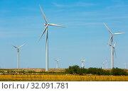 Image of wind power plants at fields near the town of La Muela (2019 год). Стоковое фото, фотограф Яков Филимонов / Фотобанк Лори