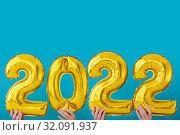 Gold foil number two thousand and twenty two 2022 celebration. Стоковое фото, фотограф Ekaterina Demidova / Фотобанк Лори