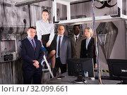 Купить «Confident businesspeople in escape room-lab», фото № 32099661, снято 29 января 2019 г. (c) Яков Филимонов / Фотобанк Лори