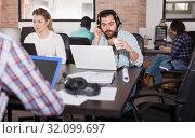 Купить «Guy in headset watching webinar», фото № 32099697, снято 16 марта 2019 г. (c) Яков Филимонов / Фотобанк Лори