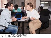 Купить «Male and female entrepreneurs discussing project», фото № 32099701, снято 16 марта 2019 г. (c) Яков Филимонов / Фотобанк Лори