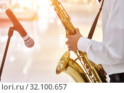 Young jazz musician plays the saxophone in a large hall. Стоковое фото, фотограф Олег Белов / Фотобанк Лори