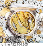 Купить «Watchmaker workshop - open retro silver pocket watch with brass clockwork on pile of clock spare parts», фото № 32104305, снято 29 января 2020 г. (c) easy Fotostock / Фотобанк Лори