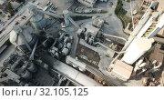 Купить «View from drone of cement plant industrial area, Catalonia, Spain», видеоролик № 32105125, снято 25 декабря 2018 г. (c) Яков Филимонов / Фотобанк Лори