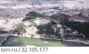 Купить «Aerial view of Plaza d'Espana with park and a bridge on ver the canal in Sevilla», видеоролик № 32105177, снято 19 апреля 2019 г. (c) Яков Филимонов / Фотобанк Лори