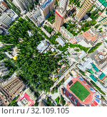 Купить «Aerial city view with crossroads and roads, houses, buildings, parks and parking lots. Sunny summer panoramic image», фото № 32109105, снято 21 января 2020 г. (c) Александр Маркин / Фотобанк Лори