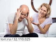 Mature girlfriend consoling grieving man sitting apart. Стоковое фото, фотограф Яков Филимонов / Фотобанк Лори