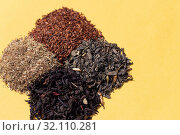 Купить «Assorted four types of dry tea: green, black leaf, rooibos super», фото № 32110281, снято 23 августа 2019 г. (c) ok_fotoday / Фотобанк Лори