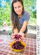 Купить «beautiful young woman washes cherries and eats», фото № 32110497, снято 7 июля 2019 г. (c) Акиньшин Владимир / Фотобанк Лори