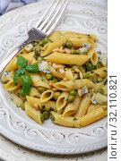 Купить «Delicious pasta with green peas, mint sauce and blue cheese in a white plate, selective focus», фото № 32110821, снято 27 августа 2019 г. (c) Марина Сапрунова / Фотобанк Лори