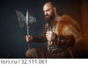Купить «Viking with axe, barbarian, side view», фото № 32111061, снято 27 марта 2019 г. (c) Tryapitsyn Sergiy / Фотобанк Лори