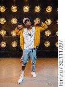 Black rapper in cap, perfomance on stage. Стоковое фото, фотограф Tryapitsyn Sergiy / Фотобанк Лори