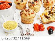 Купить «Millet muffins with dried fruit», фото № 32111569, снято 1 апреля 2019 г. (c) Надежда Мишкова / Фотобанк Лори