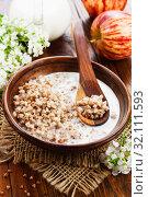 Купить «Buckwheat porridge with milk i», фото № 32111593, снято 13 мая 2019 г. (c) Надежда Мишкова / Фотобанк Лори
