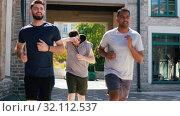 Купить «young men or male friends running outdoors», видеоролик № 32112537, снято 27 июля 2019 г. (c) Syda Productions / Фотобанк Лори