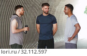 Купить «young sporty men or male friends talking outdoors», видеоролик № 32112597, снято 27 июля 2019 г. (c) Syda Productions / Фотобанк Лори