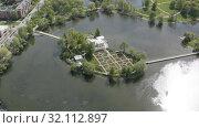 Купить «top view of a small island in the middle of a lake. Tsaritsyn island», видеоролик № 32112897, снято 19 мая 2019 г. (c) Aleksandr Sulimov / Фотобанк Лори