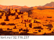 Ait Benhaddou,fortified city, kasbah or ksar, along the former caravan route between Sahara and Marrakesh in present day Morocco. It is situated in Souss Massa Draa on a hill along the Ounila River. Стоковое фото, фотограф Zoonar.com/Matej Kastelic / age Fotostock / Фотобанк Лори