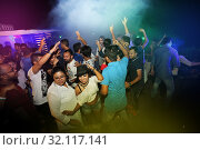 Bangladesh - October 23, 2015: People dancing and enjoying DJ Party at Picasso Restaurant in Capital city of Dhaka. Редакционное фото, фотограф Jahangir Alam Onuchcha / age Fotostock / Фотобанк Лори