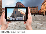 Купить «Travel concept - tourist photographs basilica San Petronio in Bologna city on tablet in Italy», фото № 32119173, снято 19 января 2020 г. (c) easy Fotostock / Фотобанк Лори