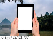Купить «Travel concept - tourist photograps river near Xingping town in Yangshuo county in China in spring morning on tablet with cut out screen for advertising logo», фото № 32121737, снято 4 августа 2020 г. (c) easy Fotostock / Фотобанк Лори