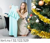 Woman choosing dress for party. Стоковое фото, фотограф Яков Филимонов / Фотобанк Лори