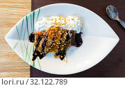 Купить «Thin pancake with chocolate, whipped cream, nut crumbs», фото № 32122789, снято 20 сентября 2019 г. (c) Яков Филимонов / Фотобанк Лори