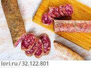 Купить «Dry cured sausage Salchichon», фото № 32122801, снято 19 сентября 2019 г. (c) Яков Филимонов / Фотобанк Лори