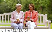 Купить «senior women or friends drinking coffee at park», видеоролик № 32123109, снято 25 августа 2019 г. (c) Syda Productions / Фотобанк Лори