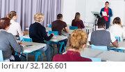 Купить «Students with teacher studying in classroom», фото № 32126601, снято 8 мая 2018 г. (c) Яков Филимонов / Фотобанк Лори