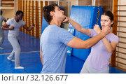 Купить «People practicing self defense techniques», фото № 32126677, снято 31 октября 2018 г. (c) Яков Филимонов / Фотобанк Лори