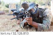 Купить «Paintball players aiming with gun in shootout outdoors», фото № 32126813, снято 11 августа 2018 г. (c) Яков Филимонов / Фотобанк Лори