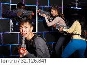 Купить «Korean guy playing lasertag», фото № 32126841, снято 23 января 2019 г. (c) Яков Филимонов / Фотобанк Лори